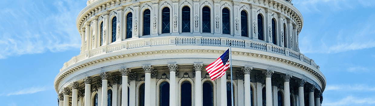 A close-up view of the exterior of the U.S. Capitol rotunda bottom levels